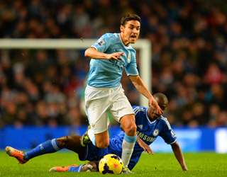 Jesus Navas challenged by Ramires (Getty Images)