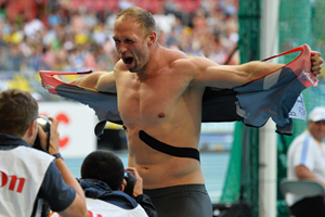 Robert Harting celebrates by ripping his shirt (Getty Images)